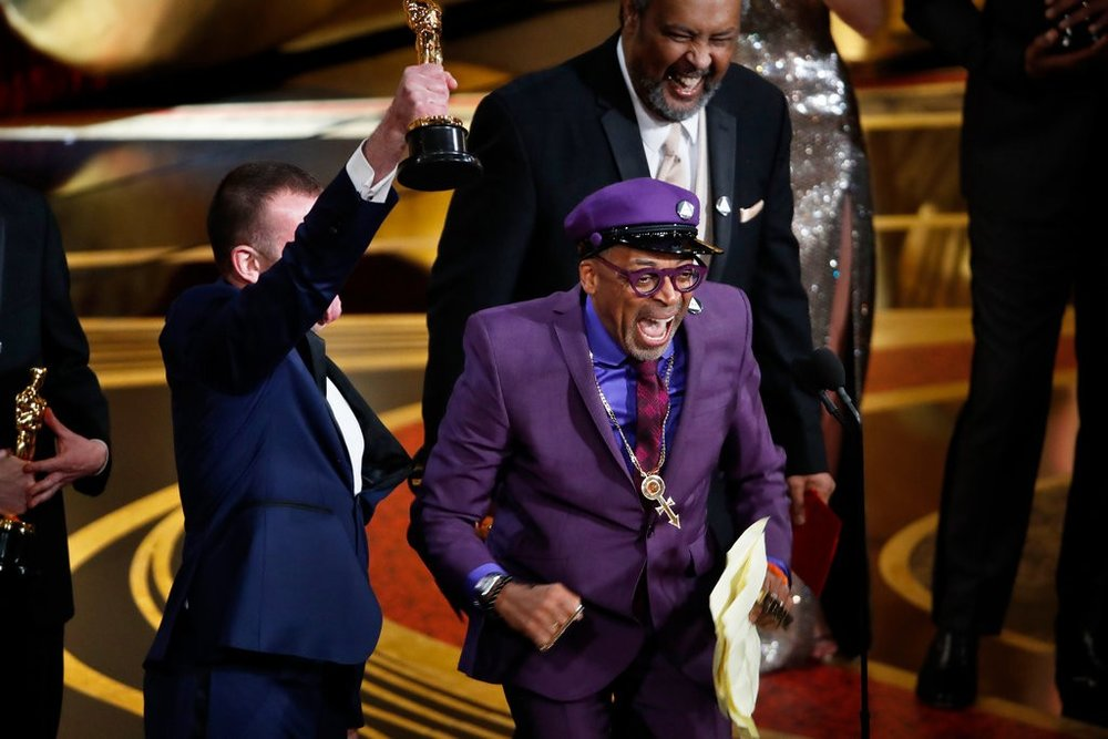 """Spike Lee accepting the award for best adapted screenplay for his film """"BlacKkKlansman"""". ©Noel West for the New York Times. Image courtesy of the New York Times"""