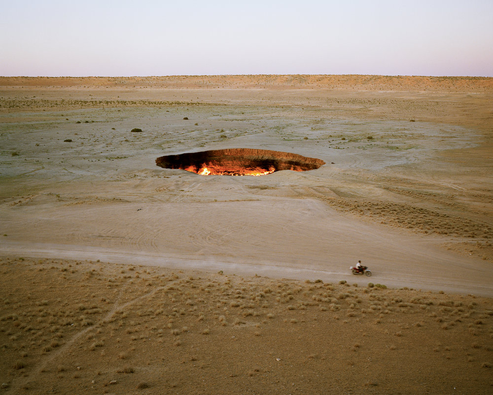 """Aperture Photographs  (Aperture, 2019). By Chloe Dewe Matthews. The """"Door to Hell."""" In 1971, Soviet geologists were drilling in the Turkmen desert when the land gave way off the excess, but the crater has been ablaze ever since. Darvaza, Turkmeinistan, 2012. Courtesy the artist."""