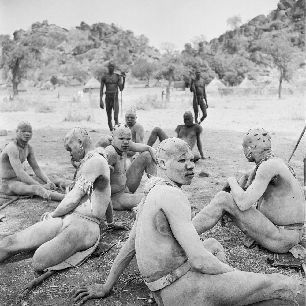 Powdered in wood ash, wrestlers of the Korongo Nuba wait to take part in a match, 1949. ©George Rodger, from  Southern Sudan . Published by Stanley/Barker.