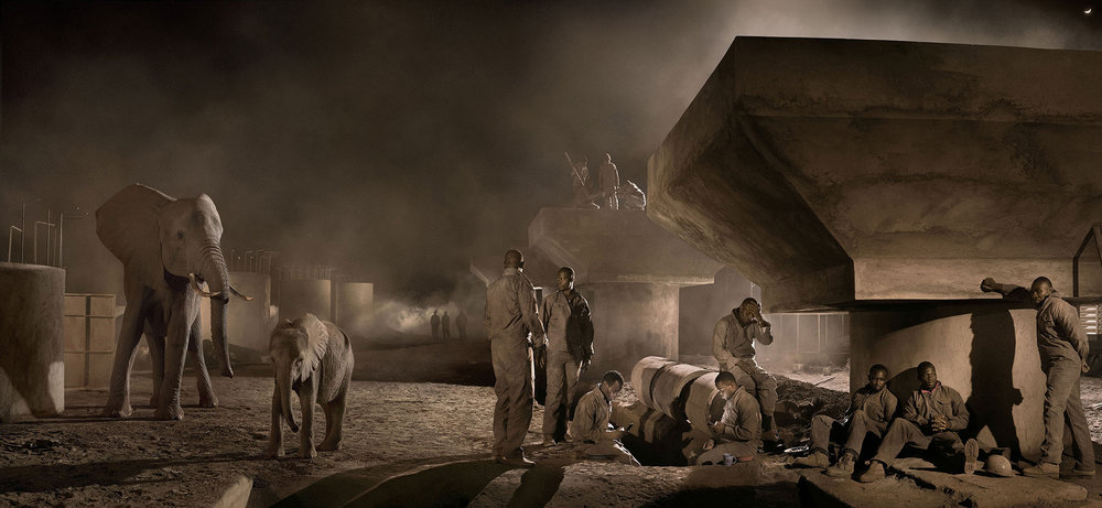 Bridge Construction with Elephants & Workers at Night. © Nick Brandt