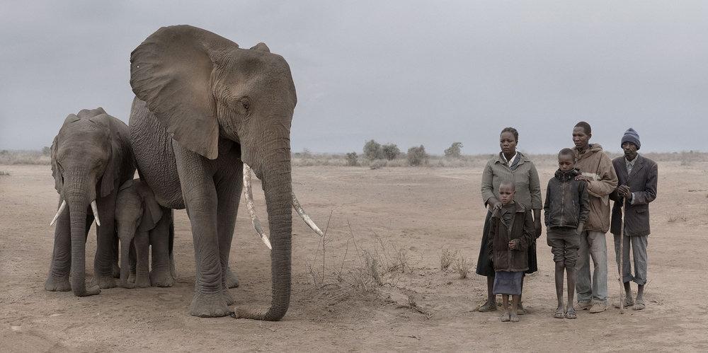 Elephant & Human Family. © Nick Brandt