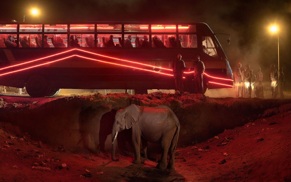 Bus Station with Elephant & Red Bus. © Nick Brandt