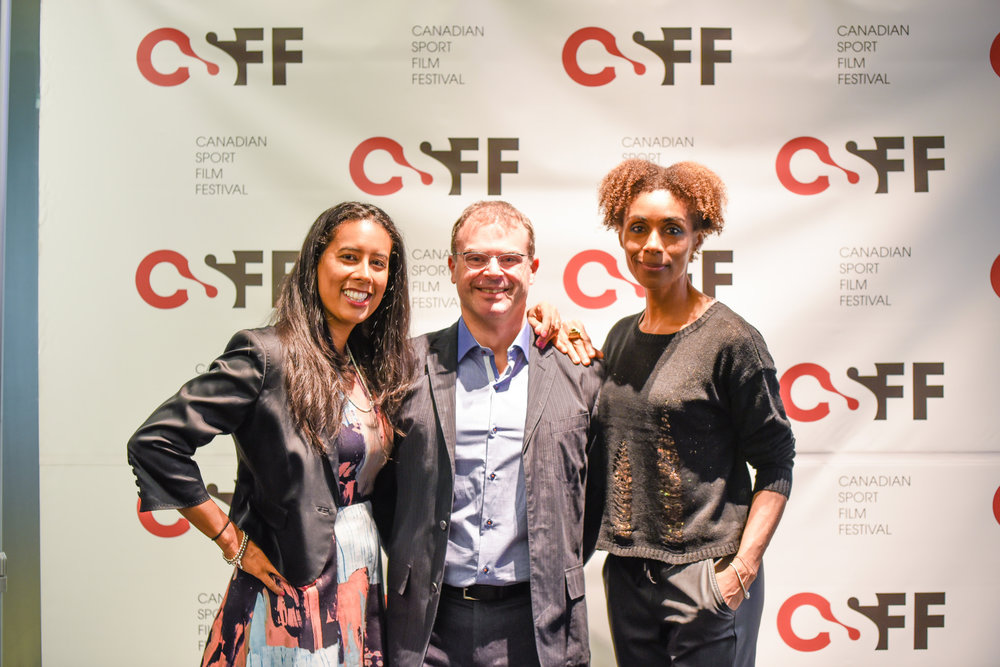 Sabrina Razack (Advisory Board), Russell Field (Executive Director), and Rosey Edeh (moderator) pose before the closing night screening of Crossing the Line.