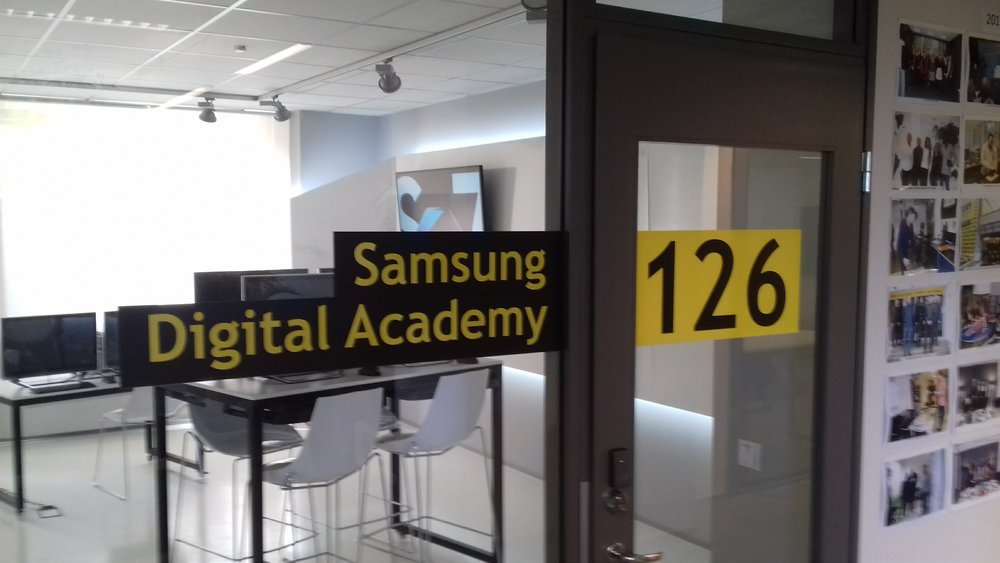 Another telecoms company sponsors a training room.