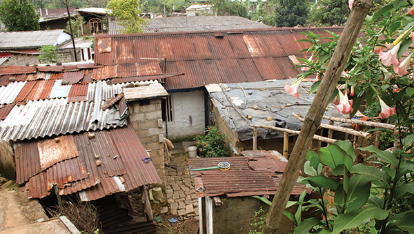 TIN HOUSES IN SRI LANKA (PHOTO COURTESY OF COMPASSION.COM)