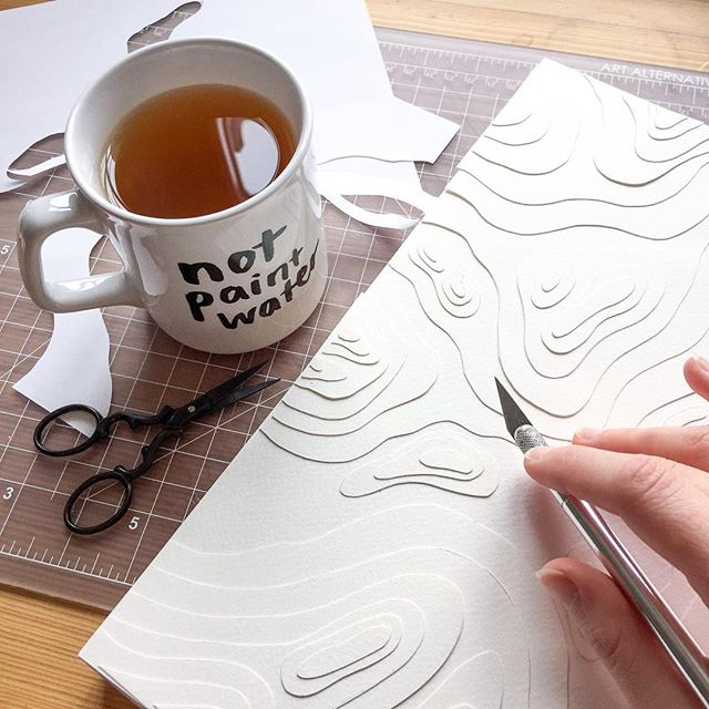 Honestly the most helpful mug I own and by Wednesday it's a necessity 🙈 WIP of a topographical paper backdrop that will sit behind a new paper sculpture! Not sure how it will turn out but I'll keep you posted on the results 😏 I hope everyone is having a wonderful week so far! 💛⠀ .⠀ .⠀ .⠀ #wip #papercut #cutpaper #paperart #paperlicious #artist #watercolorpaper #fabriano #LAartist #illustrationart #illustration #papersculpture #notpaintwater #exacto #studio #topography #nature #topo #topographical #layers #process