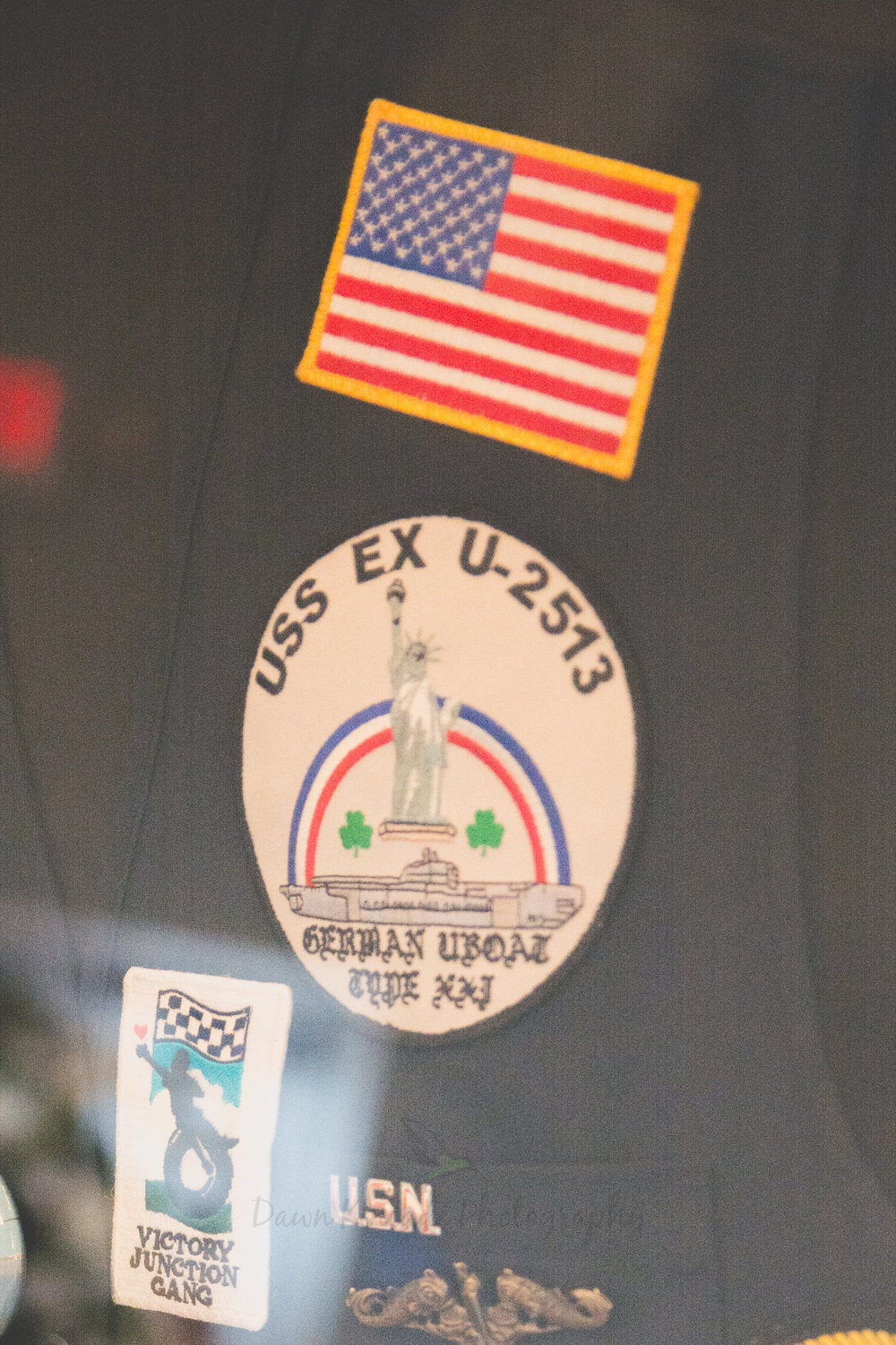 He served on the USS EX U-2513