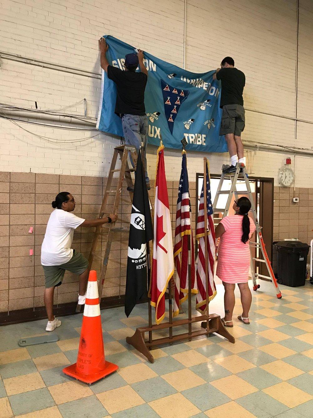 AIC Flag Hanging Lisa B Sisseton.jpg