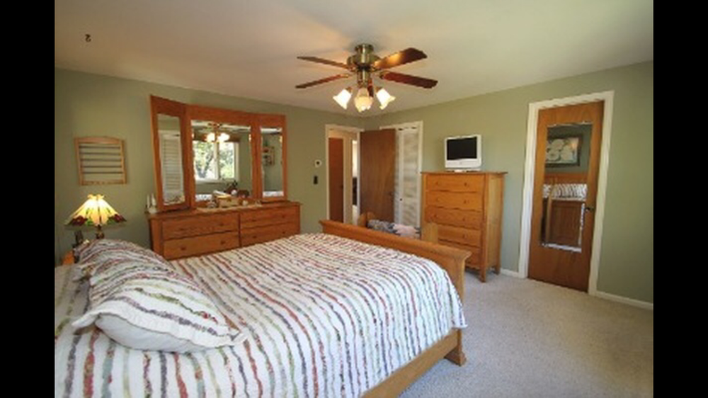 The master bedroom is a great size. We will be painting, updating the fan, flooring & doors. We are also going to create a true master bathroom and closet. The small closet is behind the bifold doors and the small bathroom is behind the mirrored door.