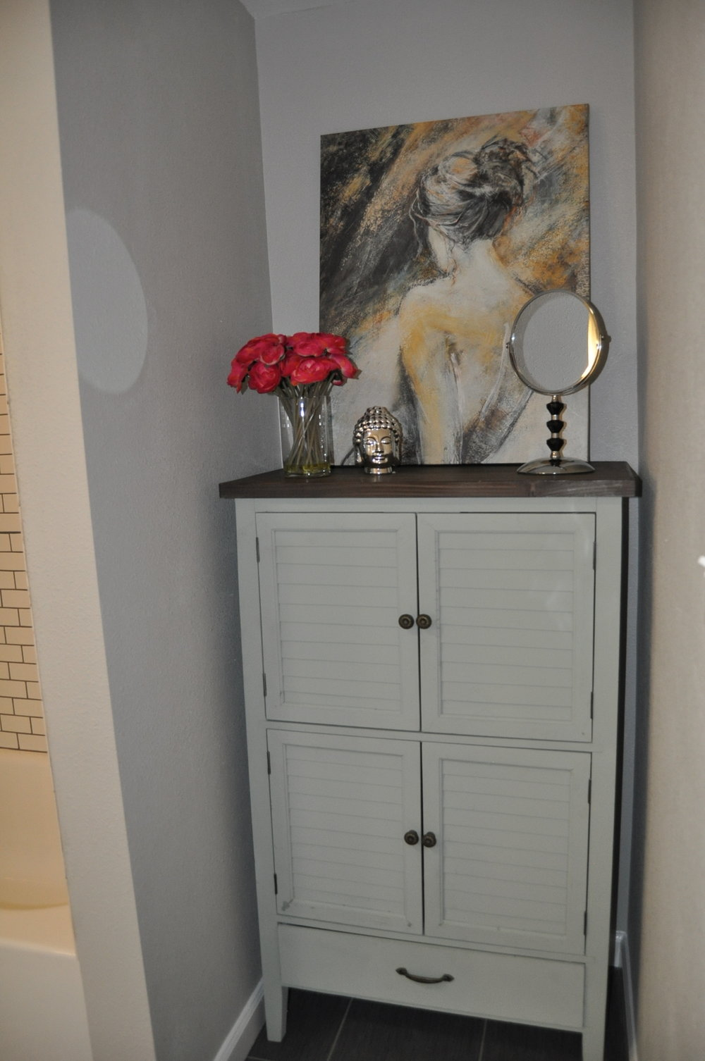 This storage unit from At Home fit perfectly in the bathroom nook