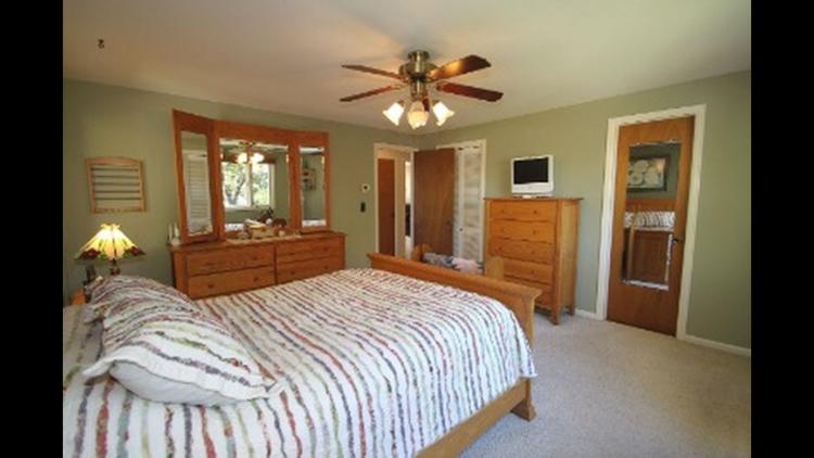 Original master bedroom with views of the old closet door and bathroom door