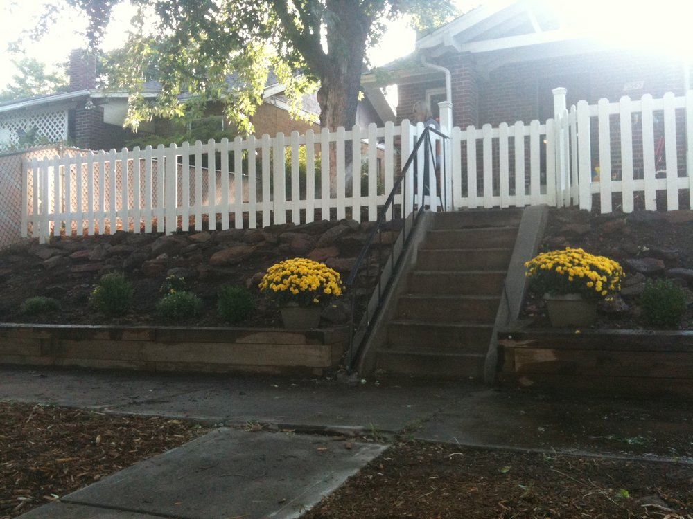 Bright new picket fence with structured garden