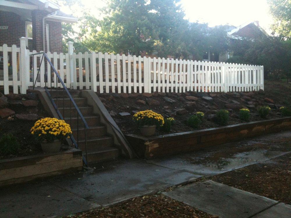 White picket fence with cleaned out flower bed