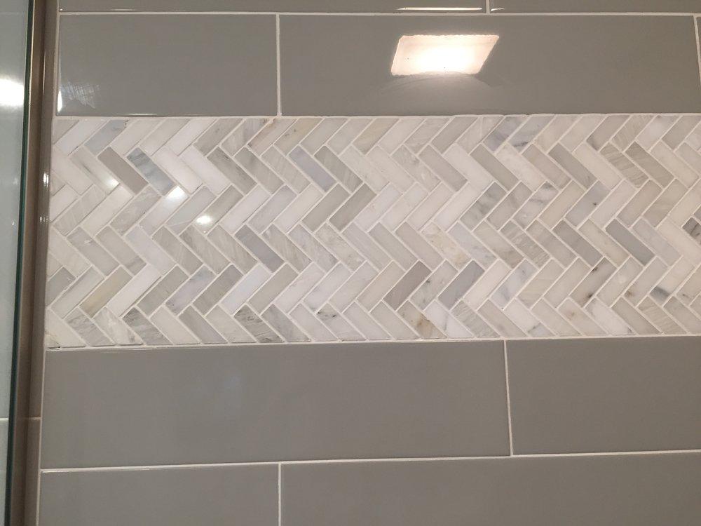 Marble herringbone tile in master bathroom | Building Bluebird