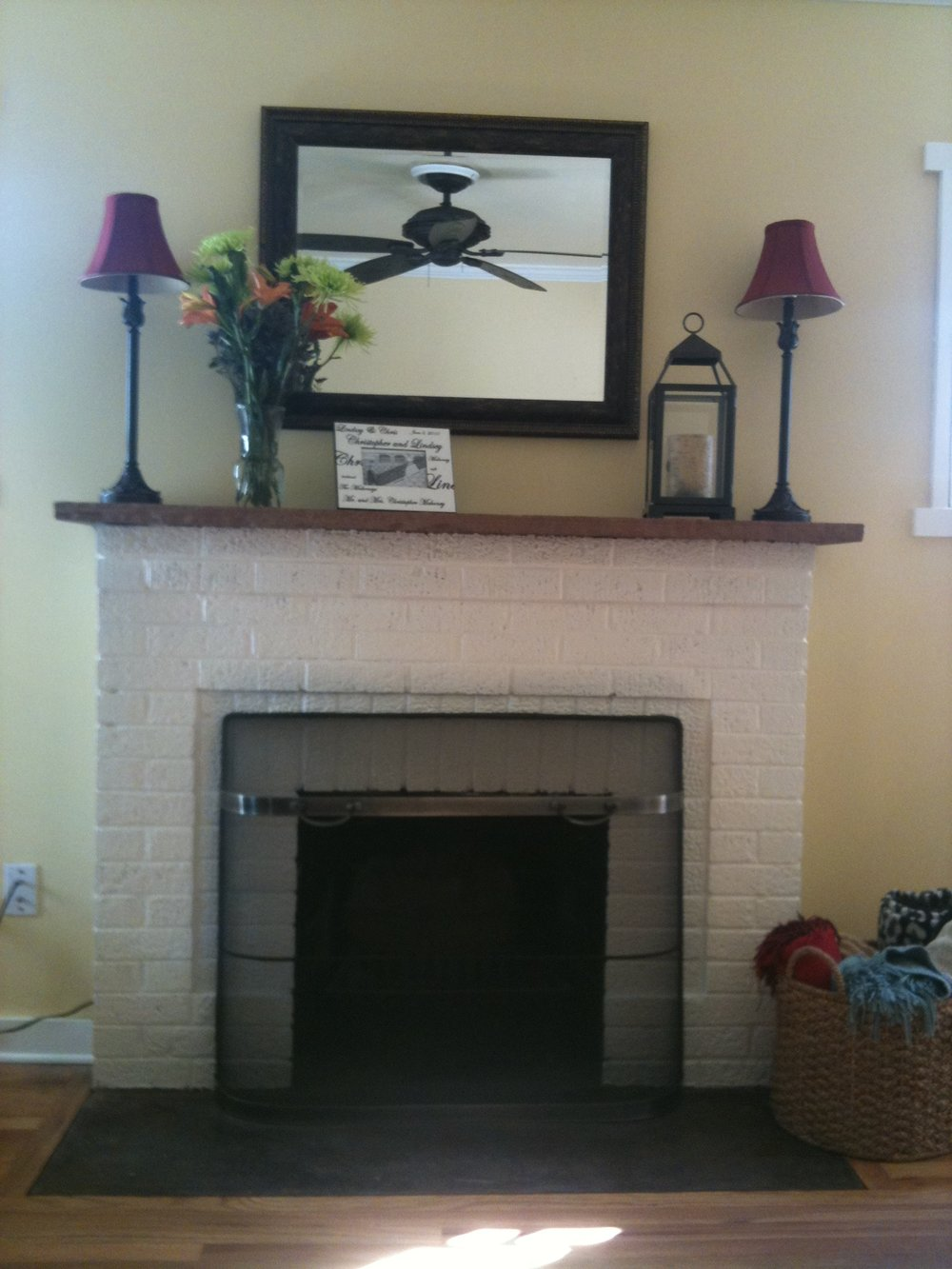 The fireplace once it was painted a fresh coat of white!