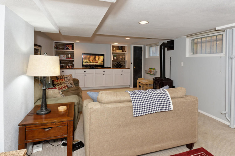 Built in TV console & storage cabinets in the basement | Building Bluebird