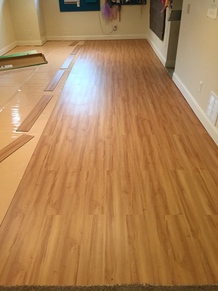 Laminate floor installation in the basement photography studio.