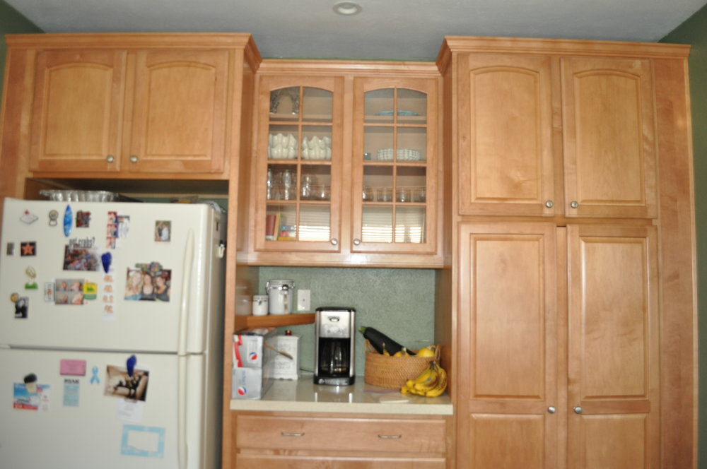 Dark walls with honey colored cabinets