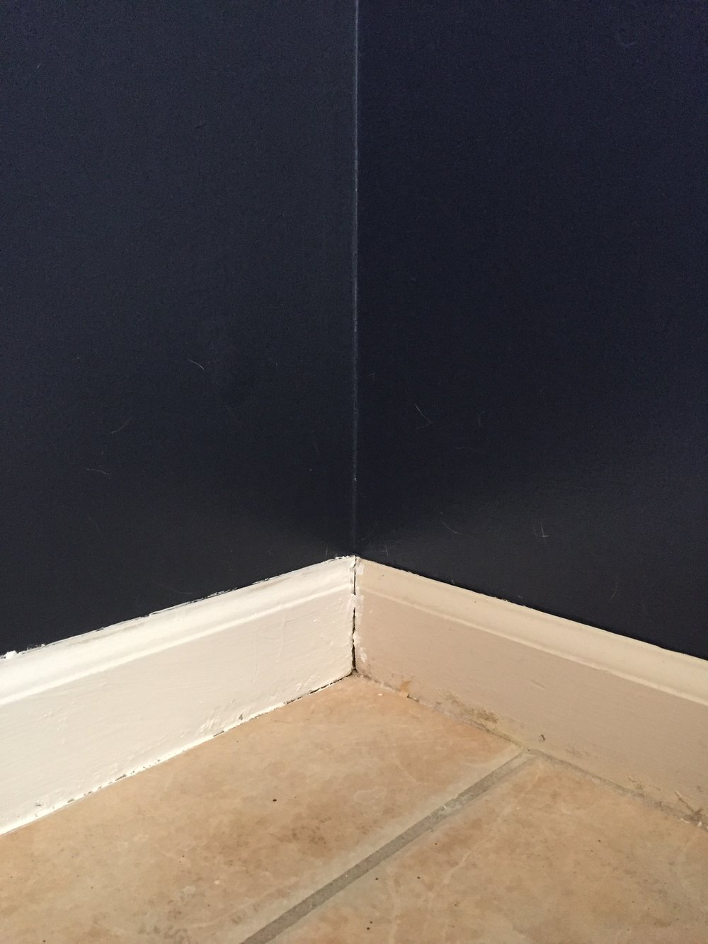 What a difference a coat of paint makes (baseboard on the left has fresh coat applied)!