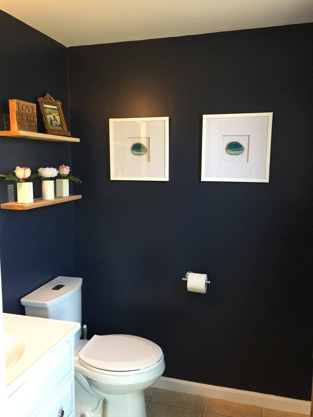 Hale Navy walls give a dramatic look to the half bathroom.