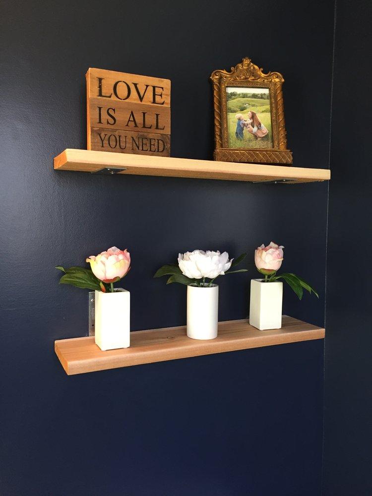 Hale Navy walls with DIY cedar shelves in the half bathroom.