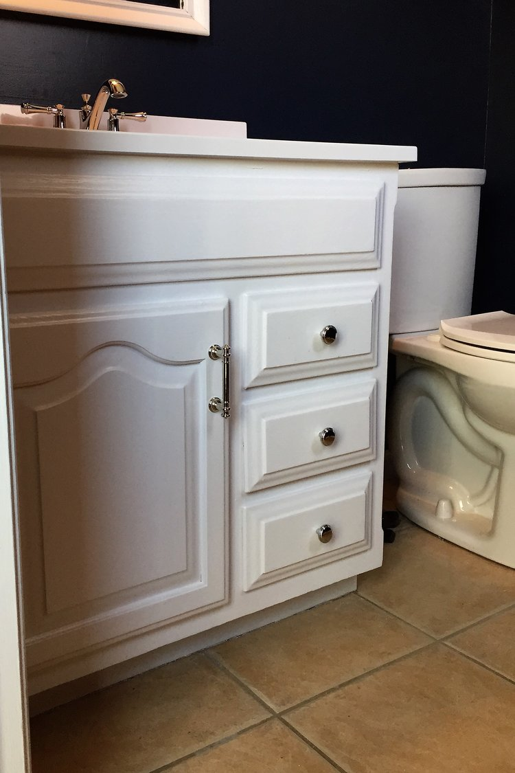 The builder grade vanity is updated with white paint and new hardware.