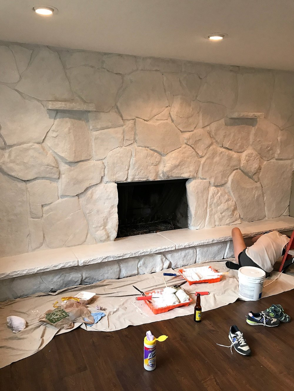 Painting the base of the fireplace