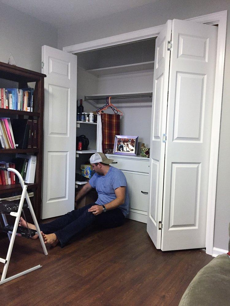 Weekend warriors installing closet doors