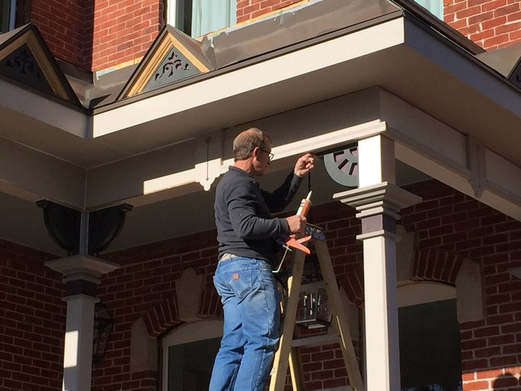 Steve paints the porch of the Bosler House