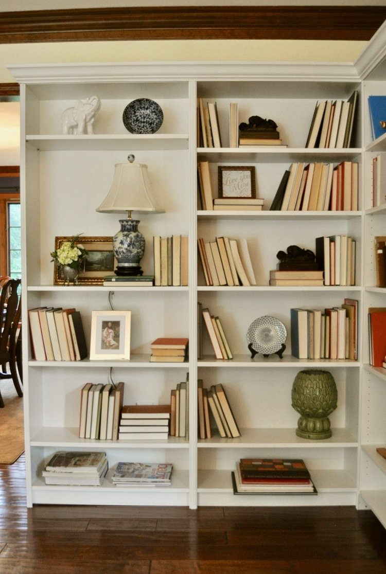 Built in bookshelves are staged for the open house