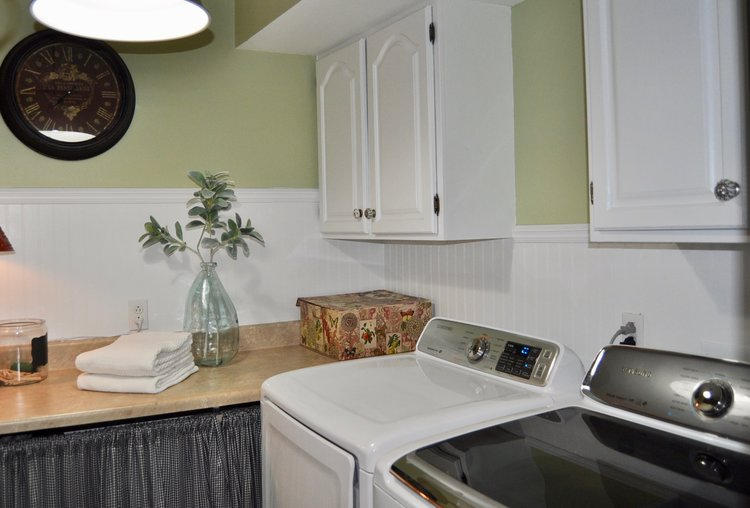 Laundry room that is loaded with function and style