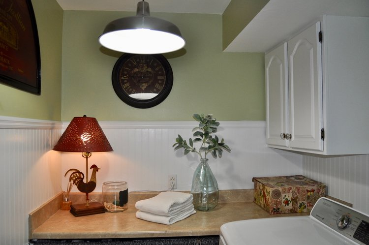 Laundry room decluttered and staged for buyers