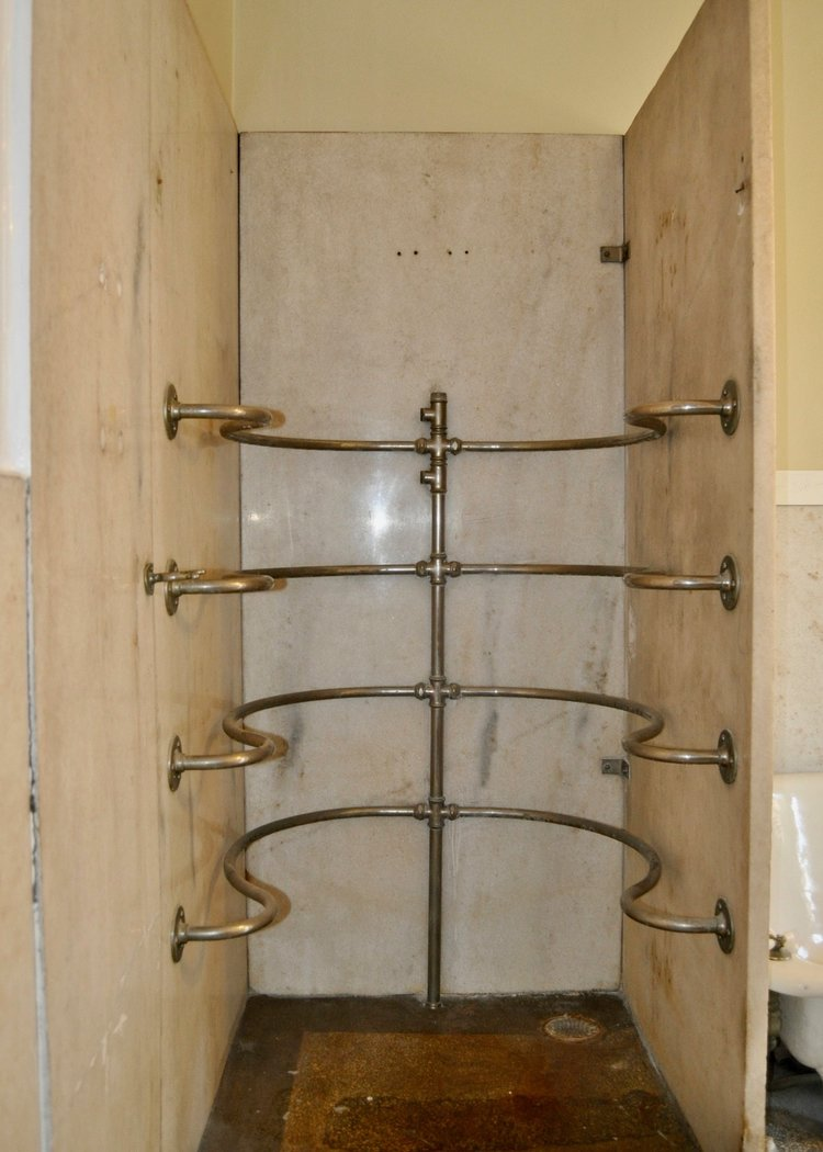 Original needle shower in historic Old West End home