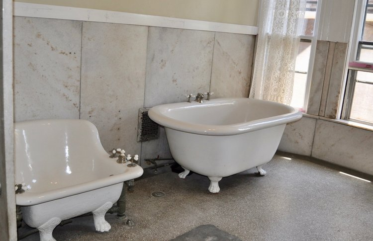 Claw foot tub and foot basin from historic Old West End home