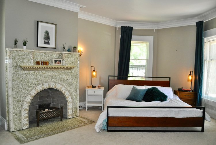 Master bedroom with original fireplace