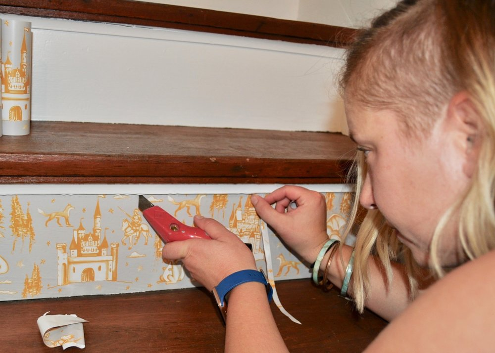 Installing removable wallpaper on the servants staircase.