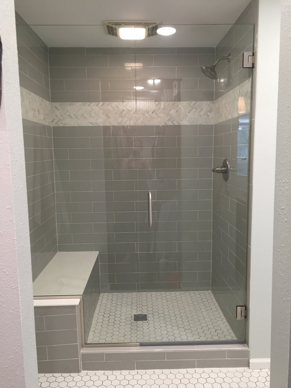 TIles are from The Tile Shop and the glass door is from Home Depot.