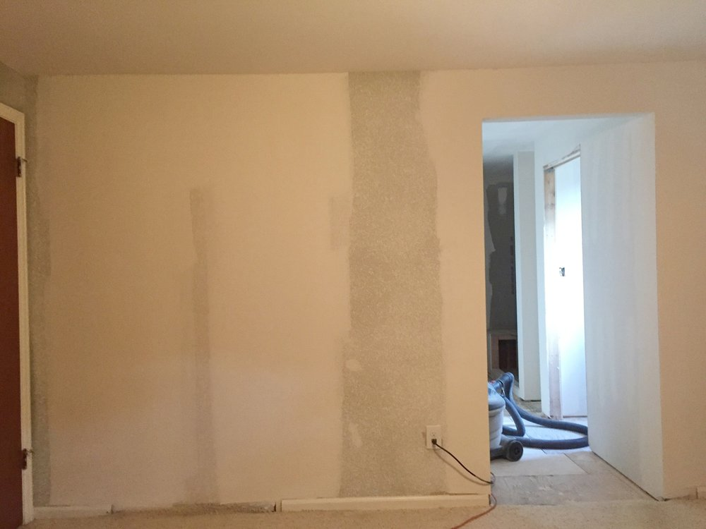 Drywall in the master suite to create new bathroom layout.
