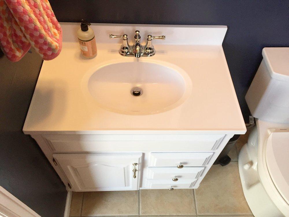 New white vanity top modernizes this space.