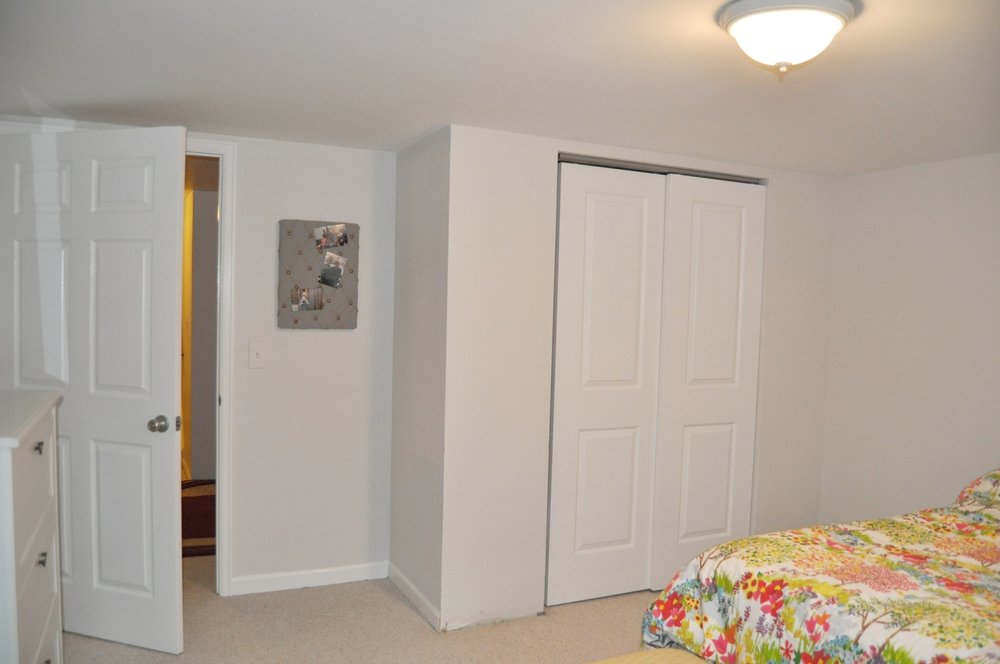 You can see that there is a small gap on the left side of the closet door. If I pushed it all the way to the left there would be a small sliver of a gap in the middle.