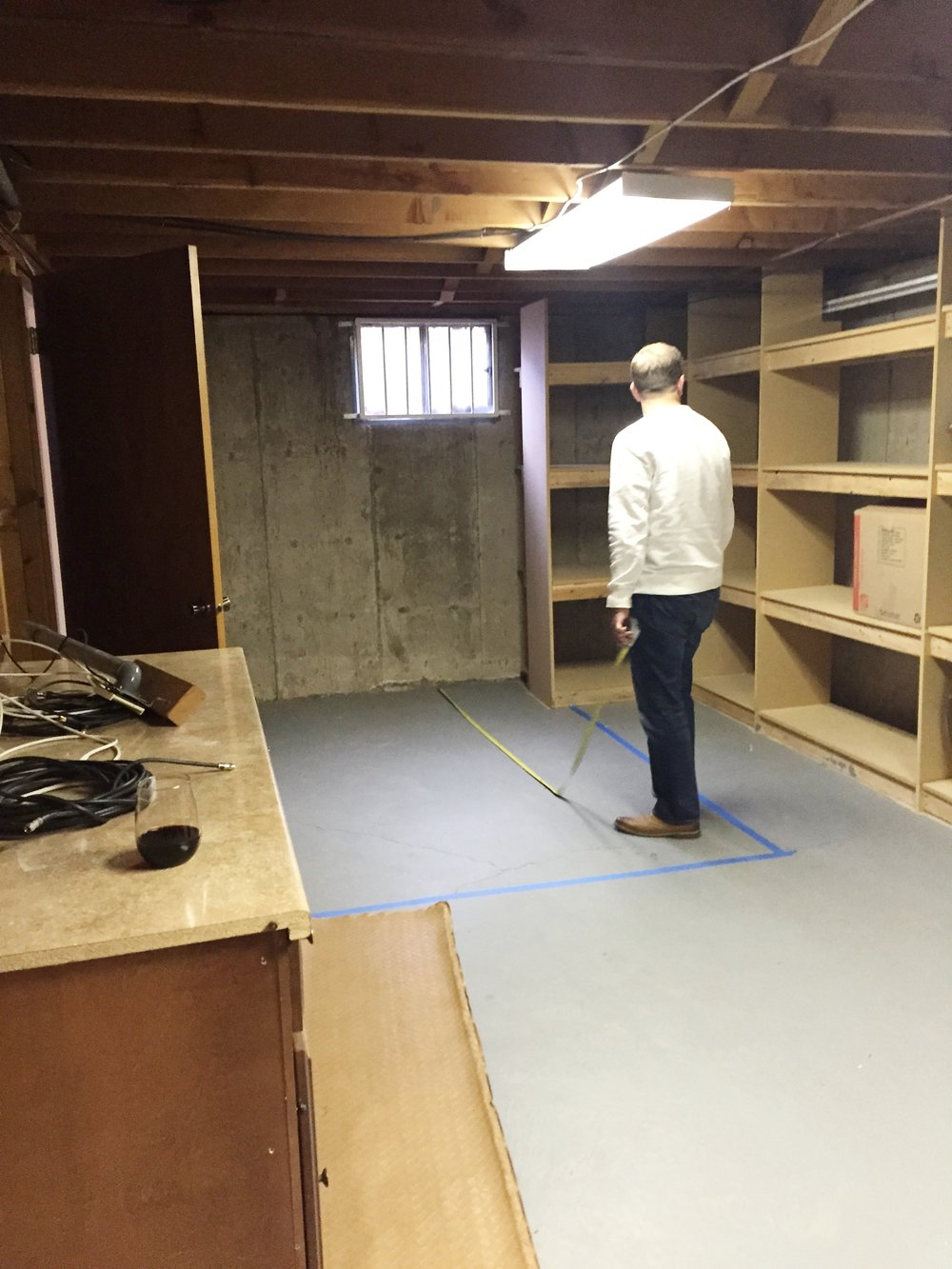 The large storage room where we would use half of the space for a bathroom