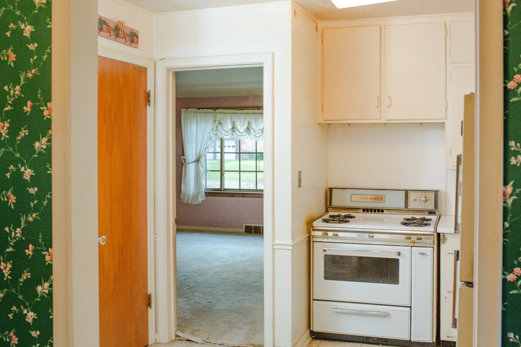 Small kitchen at the flip house before renovations