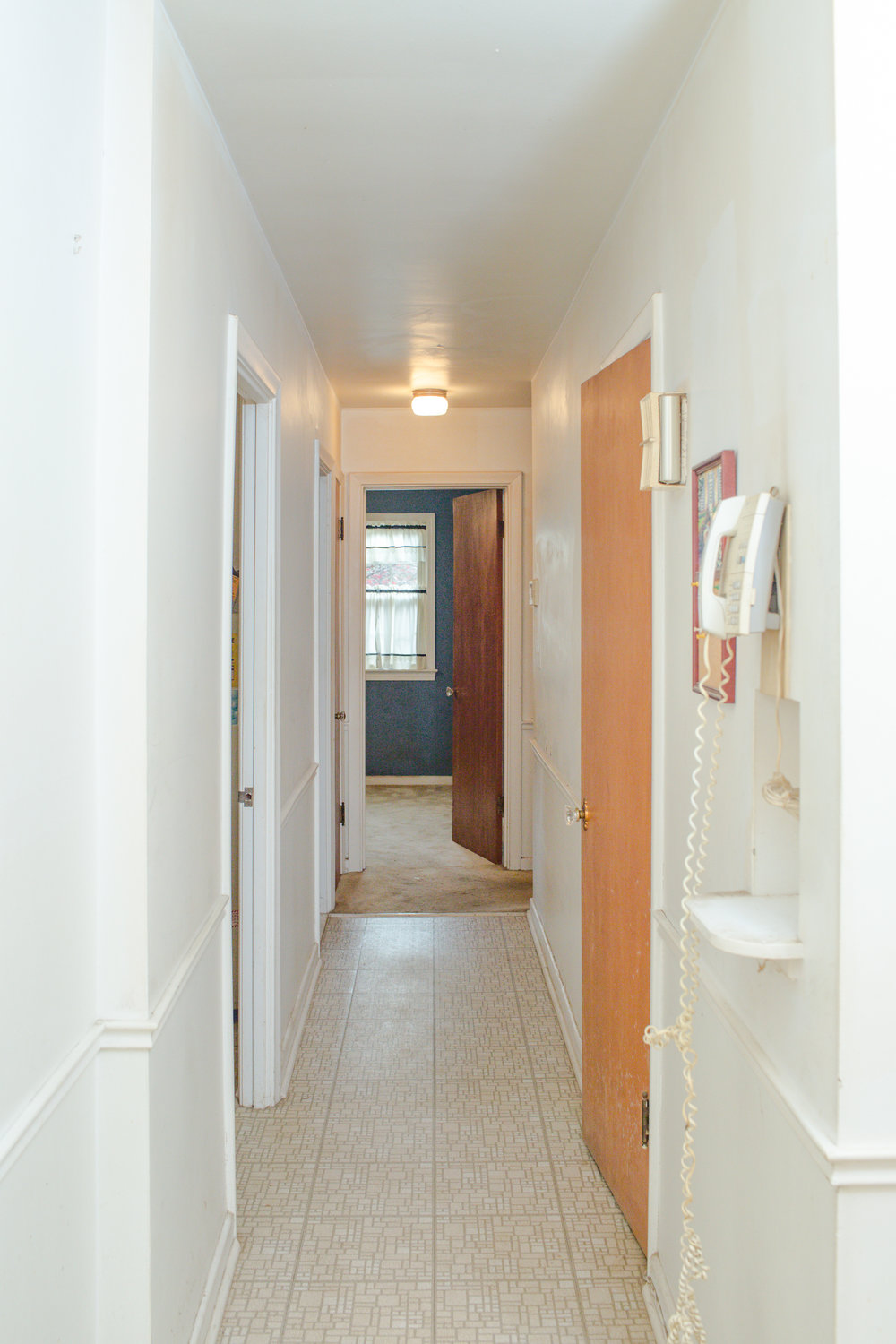 Before shot of the hallway