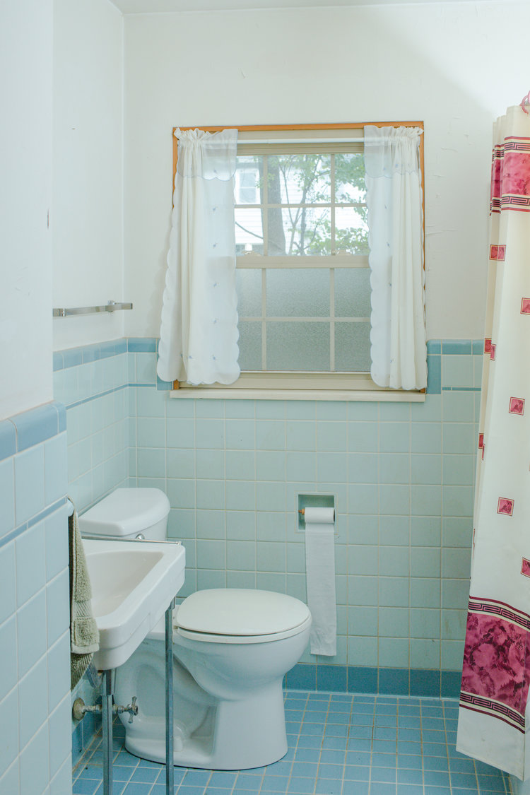 First floor vintage blue bathroom at the flip house