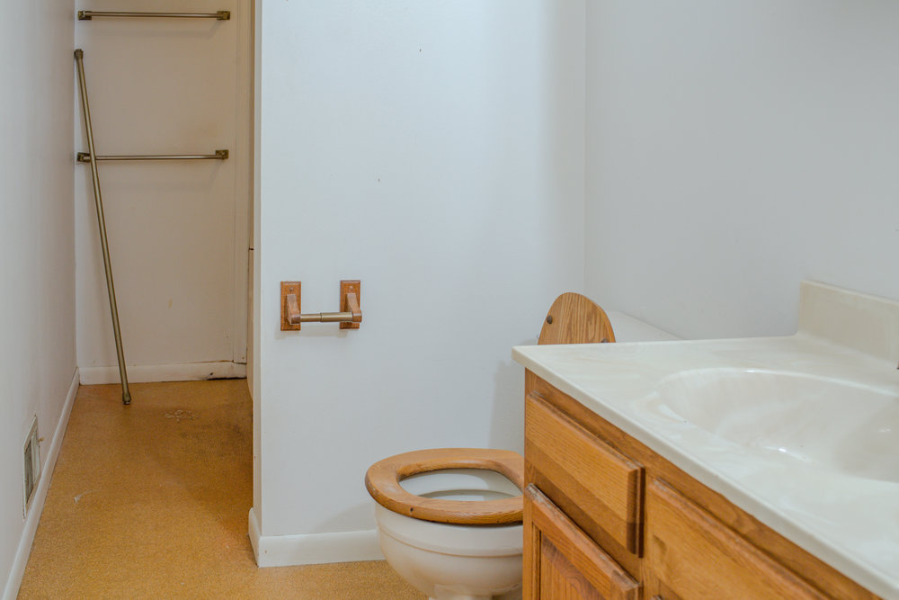 Before shot of the upstairs bathroom