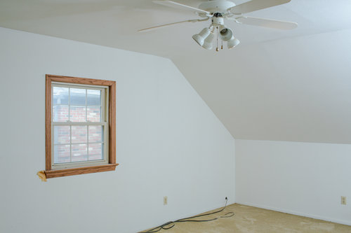 Before, the walls were cracked and dirty, the carpet was old and the ceiling fan was dated.