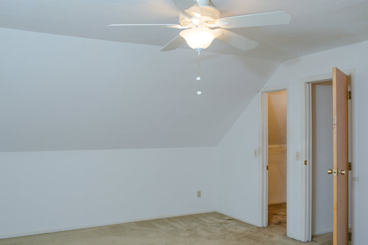 Before shot of the second upstairs bedroom