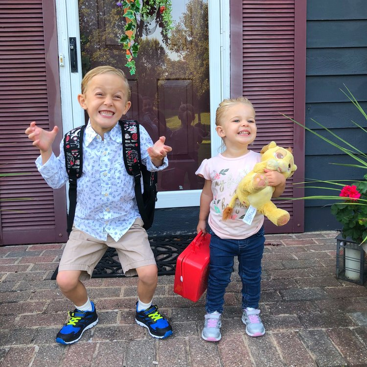 These two kids are excited to go to school