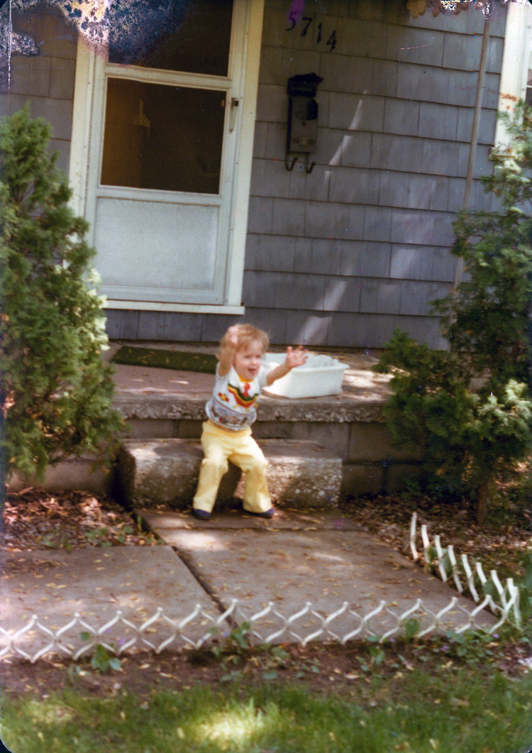 My cousin Damian is pictured on the front porch of Woody as a little child