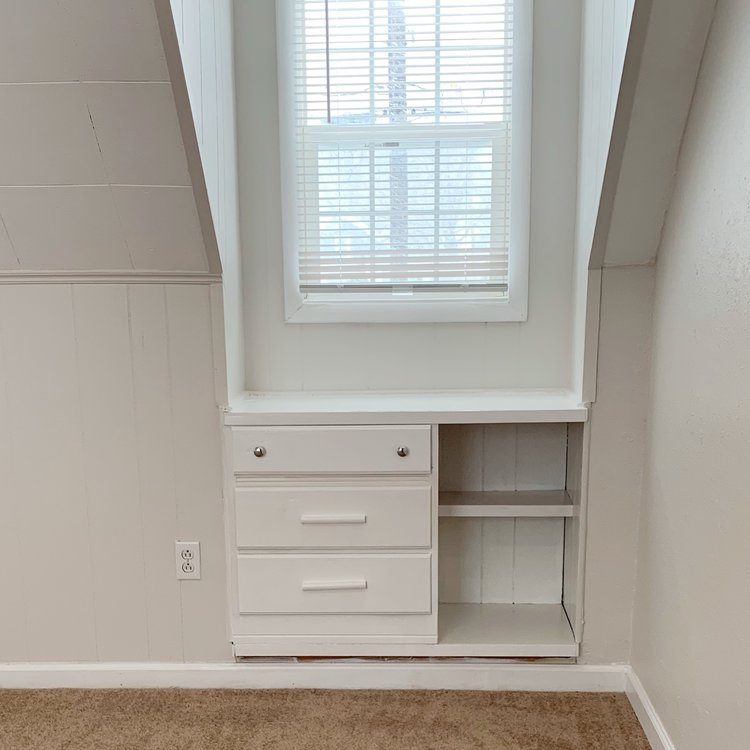 Built-in drawers we painted white and added new knobs.